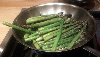 Asparagus frying in a frying pan