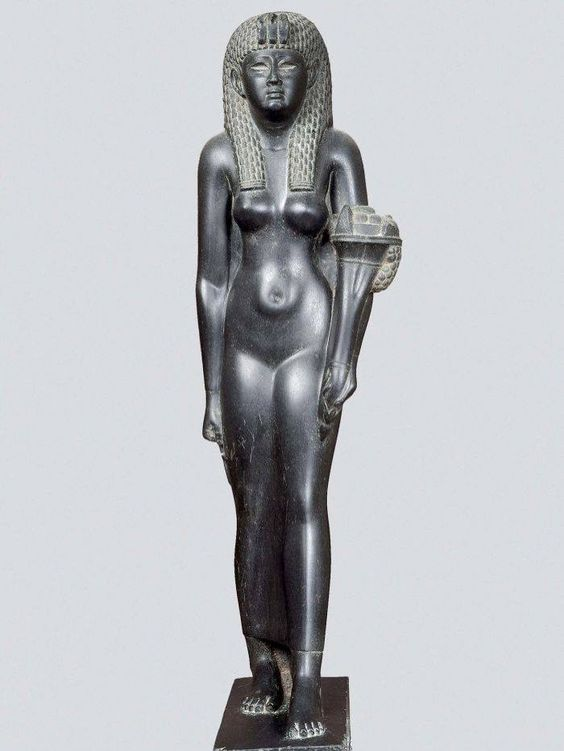 black shiny stone basalt statue of a naked woman in an Egyptian style