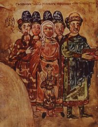a group of men and women wearing robes; the women have their hair covered