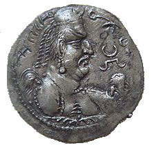 a coin with an angry-looking man on it