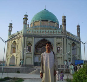 an islamic hexagonal building with a green dome