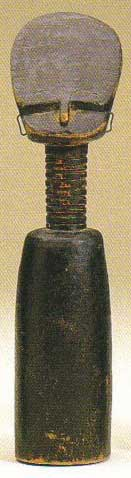 An African wood carving of a head and shoulders