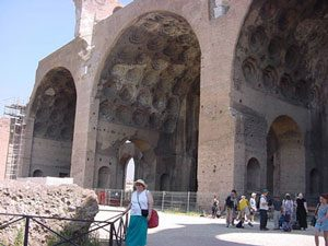 three huge brick and concrete arches over tiny people