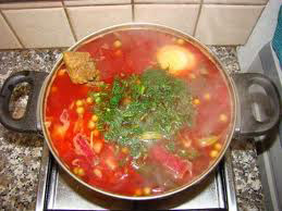 Borscht in a bowl - red soup with parsley on top