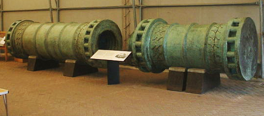two green cannon in a museum