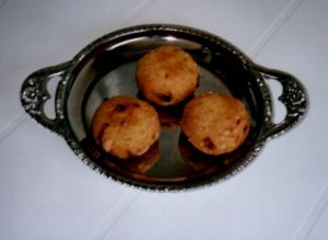 Cooked millet - brown balls in a silver dish - Early African food