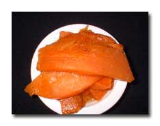 Orange slices of yam on a plate