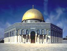 An octagonal building with a smaller gold dome on top