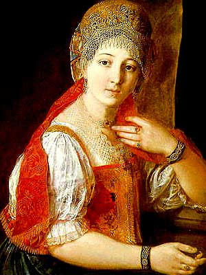 a white woman in a pretty red dress with an elaborate headdress