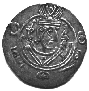 black and white photo of a coin with a man's head on it