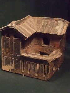 clay model of a two-story house with a small courtyard