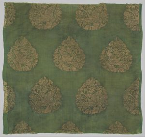 green fabric with gold embroidery of swans and leaves