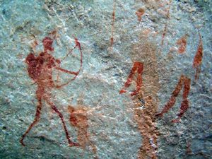 rock painting of a man with a bow and arrow and a quiver on his back