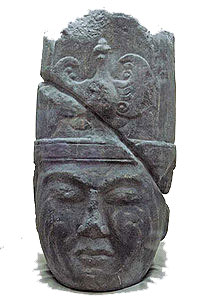 stone carving of a central asian man's head with a fancy hat on