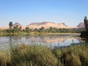 Lake Chad - a lake with dry mountains in the background. History of Chad