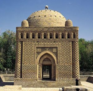 a boxy little building with lots of intricate designs all over it and a dome