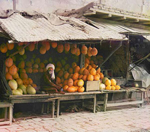 a melon stall with orange and yellow melons