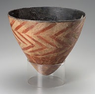 Conical vase with a pointed base, cream with zig zag red lines: early African pottery