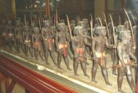 model of black men marching carrying bows and arrows