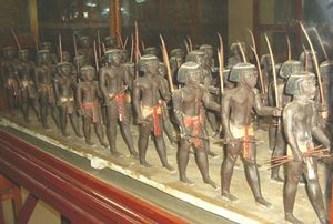 model of black men marching carrying bows and arrows: early African warfare