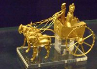 small gold model of a chariot drawn by four horses
