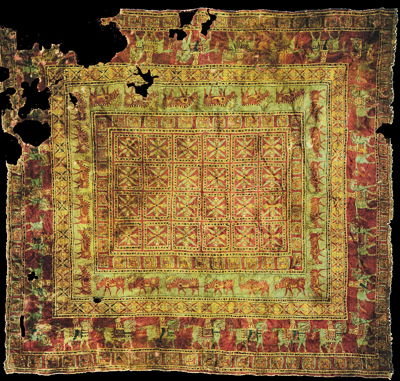 Pazyryk rug - a very old knotted carpet, much faded