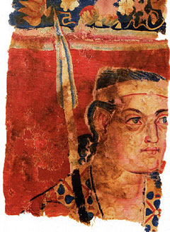 cloth with red background and image of a white person