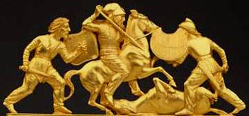 gold Scythian men fighting wearing pants and short tunics