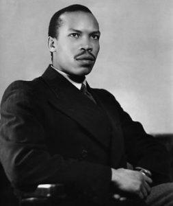 young, intense-looking black man in a dark suit