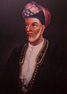 A thin older man in a turban