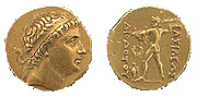 gold coin with a man's head on one side and a standing nude man on the other side