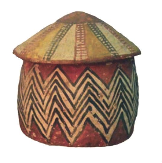 clay model house, round and red with a wide zigzag stripe of white and black all around the sides. Roof is conical and beige, with vertical red and black stripes like ladders. African architecture