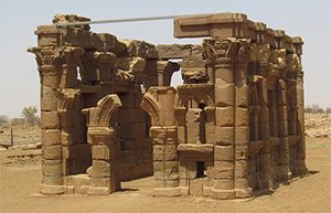 a ruined brown stone temple