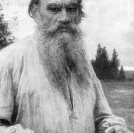 Tolstoy: an old white man with a long beard and a loose white shirt