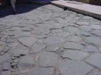 flat black stones paving a road