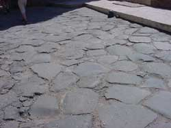 flat black stones paving a road