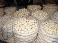 large white bags full of white balls like tennis balls