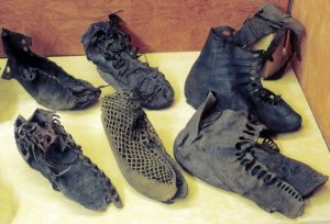 several pairs of leather shoes and boots
