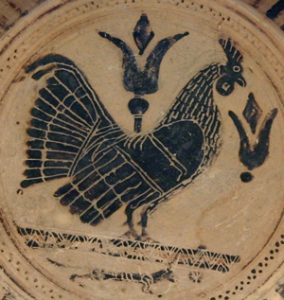 Black-figure rooster on a pottery plate