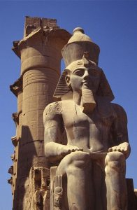 Stone statue of a seated man, the New Kingdom pharaoh Rameses II