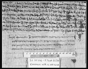 Black and white photo of some Egyptian writing with some Greek writing under it