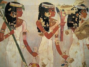 Egyptian fresco painting of three women of color in white dresses