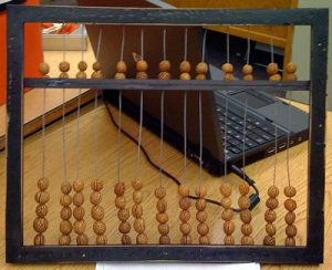 Chinese abacus, with beads strung on wires in a wooden frame