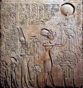 Akhenaten, Nefertiti and two of their daughters worship the aten (the sun)