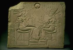 Egyptian stone carving of Nefertiti, Akhenaten, and their daughters