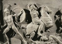 stone carving of women fighting with men on horses