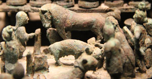 A clay model of people sacrificing animals