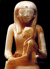 A stone statue of a woman holding a boy on her lap: Old Kingdom Egypt