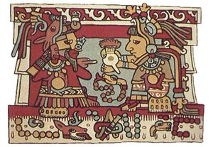 Aztec man serving a cup of cocoa