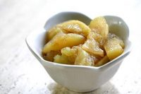 baked apples, sliced and in a small white china bowl